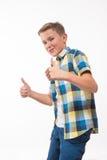 Подростковый эмоциональный мальчик в рубашке шотландки Стоковые Фотографии RF