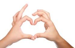 Подросток вручает форме форму сердца Стоковая Фотография RF