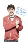 Подросток держа социальные средства подписывает усмехаться стоковое изображение rf