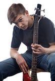 Подросток и басовая гитара Стоковые Фото