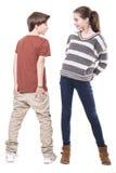 2 подросток, мужчина и женский усмехаться на одине другого Стоковые Изображения RF