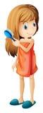 Подросток расчесывая ее волосы Стоковые Фото