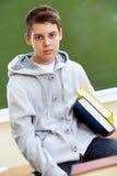 Подросток с книгами Стоковое фото RF