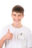 Подросток с пустым значком Стоковые Изображения RF