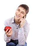 Подросток с Яблоком и мобильным телефоном стоковое фото rf