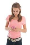 Подросток с smartphone Стоковое Фото