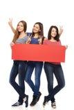 3 подруги с Красным знаменем Стоковая Фотография