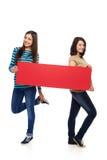 2 подруги с Красным знаменем Стоковое Изображение RF