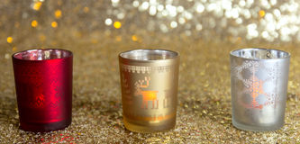 Подсвечники красного цвета, золота и серебра стоковое фото rf