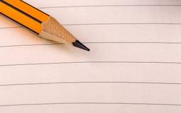 Подсказка карандаша на выровнянной бумаге Стоковая Фотография RF