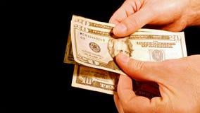 Подсчитывать счеты долларов наличных денег денег в руках Стоковое фото RF