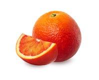 Полтора апельсин красного цвета над белой предпосылкой Стоковое Фото