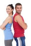 Подходящий человек и женщина усмехаясь на камере совместно Стоковая Фотография RF
