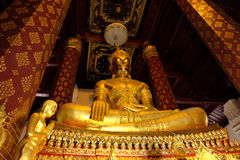 Подчиняющ изображение Mara Будды Wat Nah Phramen Стоковое Изображение RF