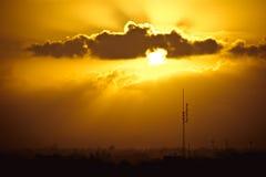 Подъем Солнця над городом Стоковое Изображение