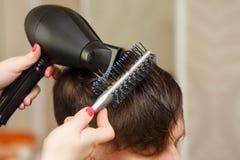 Польза фена для волос стоковое фото rf