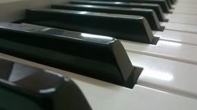 пользует ключом рояль стоковая фотография