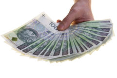 Польские банкноты валюты 100 злотых штабелированных в руке Стоковое фото RF