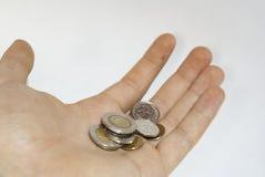 Польские монетки в руке Стоковые Изображения