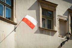 Польский флаг в Кракове, Польша, Европа Стоковое Фото