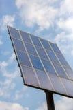 Поляк при панели солнечных батарей делая электричество Стоковая Фотография