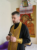 Правоверная младенческая церемония крещения дома в Беларуси Стоковое Фото