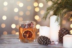 Праздничная карточка с свечами и конусами под рождественской елкой Стоковые Фото