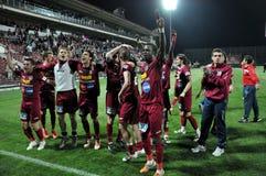 праздновать победу футбола игроков Стоковые Изображения