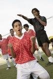 праздновать футбол игрока Стоковые Изображения RF