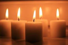 Праздник миражирует горение на белой предпосылке и Стоковые Фото
