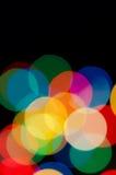 Праздничная предпосылка с покрашенными светами Стоковые Изображения RF