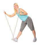 практикует женщину веревочки прыгая Стоковая Фотография