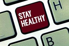 Пребывание текста почерка здоровое Концепция знача Keep сбалансированную диету терпит хорошие физическое состояние и здоровье стоковое изображение