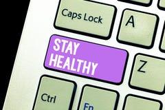 Пребывание текста почерка здоровое Концепция знача Keep сбалансированную диету терпит хорошие физическое состояние и здоровье стоковая фотография rf