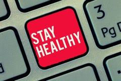 Пребывание текста сочинительства слова здоровое Концепция дела для Keep сбалансировала диету терпит хорошие физическое состояние  стоковое фото rf