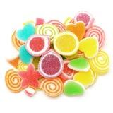Превращать помадку конфеты при сахар изолированный на белизне Стоковое Изображение