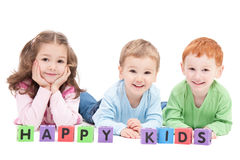преграждает малышей 3 детей счастливых Стоковые Фотографии RF