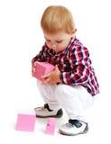преграждает мальчика немногая играя стоковая фотография