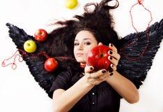 предлагать девушки черноты яблока ангела Стоковая Фотография