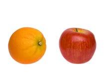 Предметы - яблоки и померанцы стоковые изображения