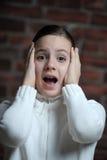 Предназначенная для подростков девушка испуганная стоковое фото rf