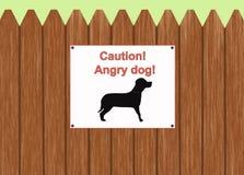 Предосторежение - сердитая собака Стоковые Фото