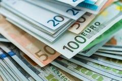 Предпосылка банкнот денег евро и доллара США Стоковые Изображения RF