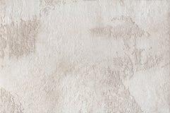 Предпосылка - бежевый гипсолит, декоративные заволакивания стены Стоковое Фото