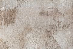 Предпосылка - бежевый гипсолит, декоративные заволакивания стены Стоковые Изображения