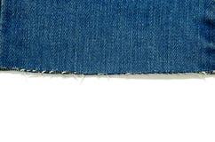 предпосылка белизны джинсов края стоковое фото