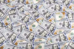 Предпосылка валюты долларов Соединенных Штатов, новые 100 денег США Стоковая Фотография