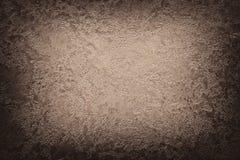 Предпосылка виньетки текстуры темного коричневого цвета бежевая абстрактная Стоковые Изображения
