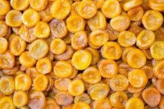 Предпосылка высушенных абрикосов, консервация тропических плодов в рынках для подарка стоковая фотография
