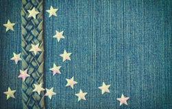 Предпосылка голубой джинсовой ткани текстурная, джинсы пояс, звезды Стоковое Фото